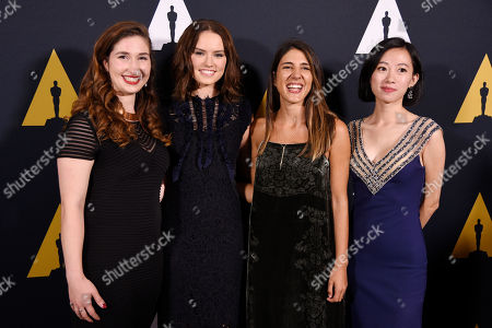 Presenter Daisy Ridley, second from left, poses with student Academy Award winners in the documentary category at the 43rd Annual Student Academy Awards at the Academy of Motion Picture Arts and Sciences, in Beverly Hills, Calif. From left to right are Elise Conklin of Michigan State University, Daphne Matziaraki of the University of California at Berkeley and Rongfei Guo of New York University
