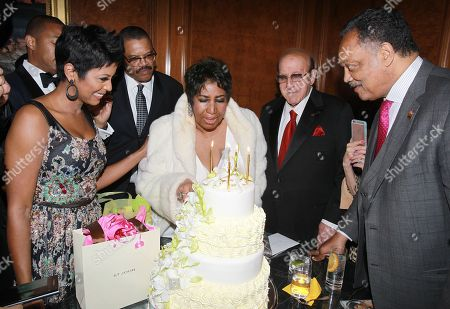 Stock Image of Reporter Tamron Hall, from left, Willie Wilkerson, singer Aretha Franklin, music executive Clive Davis and Rev. Jesse Jackson Sr. attend Aretha Franklin's 74th Birthday Celebration at the Ritz-Carlton, in New York