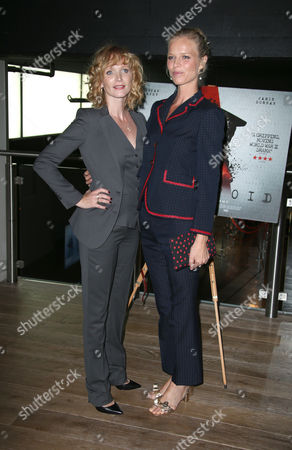Actress Anna Geislerova, left, and model Eva Herzigova pose for photographers upon arrival at the premiere of the film 'Anthropoid' in London