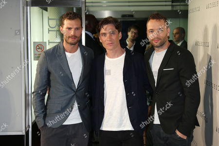 Actors Jamie Dornan, left, Cillian Murphy and director Sean Ellis, pose for photographers upon arrival at the premiere of the film 'Anthropoid' in London