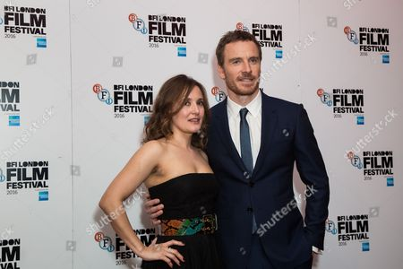 Actors Lyndsey Marshal and Michael Fassbender pose for photographers on arrival at the premiere of the film 'Trespass Against Us', showing as part of the London Film Festival in London