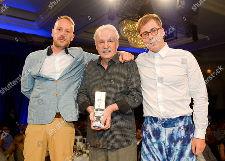 Simon Ratcliffe, Giorgio Moroder and Felix Buxton during the Nordoff Robbins O2 Silver Clef Awards 2014 at the Hilton Hotel in London on
