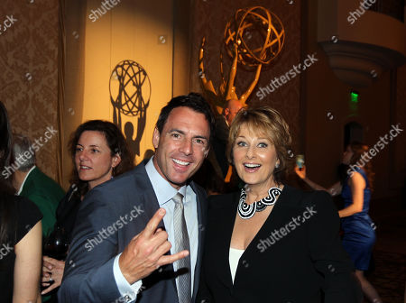 Mark Steines, left, and Cristina Ferrare attend the Daytime Emmy Nominee Cocktail Reception in Beverly Hills, Calif., on