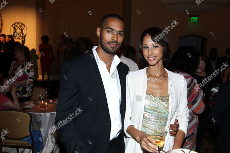 Lamon Archey, left, and a guest attend Daytime Emmy Nominee Cocktail Reception in Beverly Hills, Calif., on