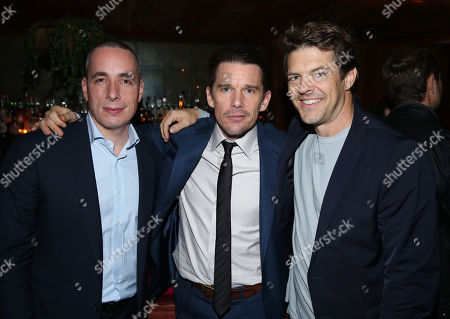 Stock Picture of Details Editor and Chief Dan Peres, and from left, Ethan Hawke and Jason Blum attend the DETAILS Hollywood Mavericks Dinner at Soho House, in West Hollywood, Calif