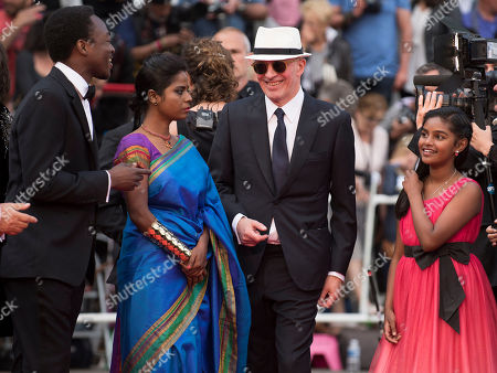 Marc Zinga, Kalieaswari Srinivasan, director Jacques Audiard and Claudine Vinasithamby arrive for the screening of the film Dheepan at the 68th international film festival, Cannes, southern France