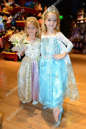 Mia Talerico, dressed up as Rapunzel, and McKenna Grace dressed up as Elsa from Disney's 'Frozen', pose at Disney Storeâ?™s Halloween BOOtique Party, in Glendale, CA