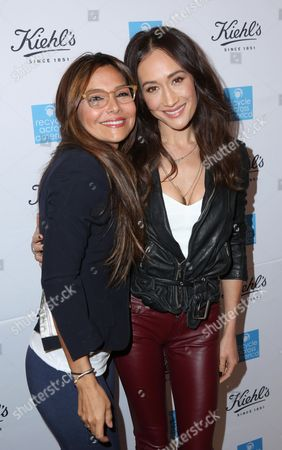 Maggie Q, right, and Vanessa Marcil attend the Kiehl's Earth Day Party co-hosted by Elizabeth Olsen and Maggie Q benefitting Recycle Across America at the Kiehl's Since 1851 store in Santa Monica, Calif. on