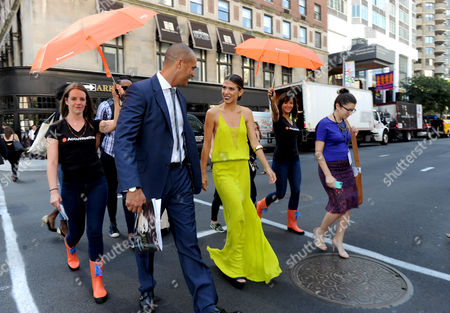 America's Next Top Model judge Nigel Barker, left, and designer and E! News correspondent Orly Shani are escorted by the AccuWeather MinuteCast team to New York Fashion Week, . The AccuWeather MinuteCast Storm Squad is at this year's Fashion Week to help attendees stay one step ahead of any possible precipitation and to navigate any Prada-ruining puddles