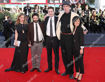 From left, actress Jennifer Jason Leigh, directors Charlie Kaufman and Duke Johnson, actor Tom Noonan and producer Rosa Tran pose for photographers on the red carpet for the film Anomalisa, at the 72nd edition of the Venice Film Festival in Venice, Italy, . The 72nd edition of the festival runs until Sept. 12