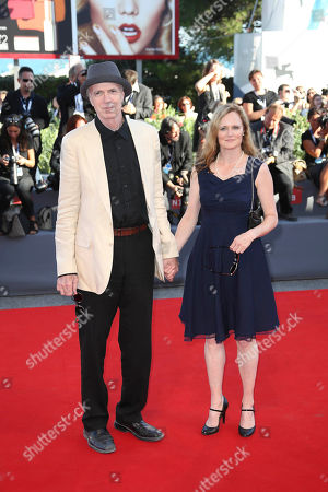 Actors Tom Noonan, left, and Jennifer Jason Leigh pose for photographers on the red carpet for the film Anomalisa, at the 72nd edition of the Venice Film Festival in Venice, Italy, . The 72nd edition of the festival runs until Sept. 12