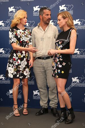 Elizabeth Banks, Francesco Munzi and Diane Kruger pose for photographers at the photo call for the Jury at the 72nd edition of the Venice Film Festival in Venice, Italy, . The 72nd edition of the festival runs until Sept. 12