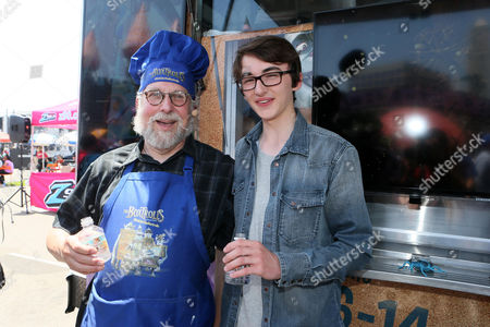 """Chef David George Gordon and Isaac Hempstead-Wright at Focus Feature's """"#EatLikeABoxtroll"""" Bug Truck at 2014 Comic-Con, in San Diego, CA"""