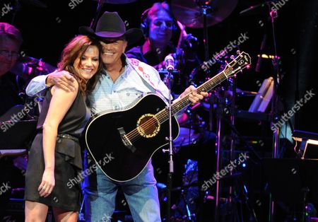 Martina McBride and George Strait perform at the George Jones Tribute - Playin' Possum: The Final No Show, on at the Bridgestone Arena in Nashville, Tenn