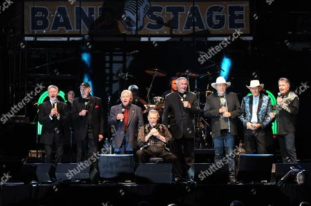 Stock Image of Larry Gatlin, Ray Stevens, John Conlee, Stonewall Jackson, Jim Ed Brown, Bobby Bear, and Jimmy C. Newman perform at the George Jones Tribute - Playin' Possum: The Final No Show, on at the Bridgestone Arena in Nashville, Tenn