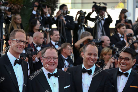 Director Pete Docter, chief creative officer at Pixar John Lasseter, producer Jonas Rivera and Co-director Ronnie Del Carmen pose for photographers upon arrival at the screening of the film Inside Out at the 68th international film festival, Cannes, southern France