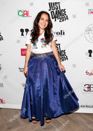 Stock Photo of Designer Stacy Igel walks the red carpet following the Just Dance with Boy Meets Girl fashion show in New York City. The highly anticipated Just Dance 2014 is due out in October