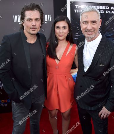"""Len Wiseman, from left, Kaley Romo and Roland Emmerich arrive at the premiere of """"Independence Day: Resurgence"""" at the TCL Chinese Theatre, in Los Angeles"""