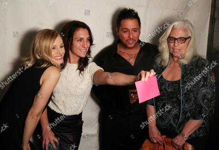 """Actors Kristen Bell, left, and Francis Capra, second from right, take pictures with Kickstarter backers at the after party for the premiere of """"Veronica Mars"""", in Los Angeles"""