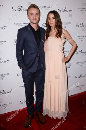 """Tom Felton, left, and Jade Olivia arrive at the Los Angeles premiere of """"In Secret"""" at ArcLight Cinemas Hollywood on"""