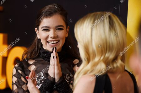 "Hailee Steinfeld, left, a cast member in ""Edge of Seventeen,"" mingles with the film's writer/director Kelly Fremon Craig at a special screening of the film at the Regal LA LIVE theaters, in Los Angeles"