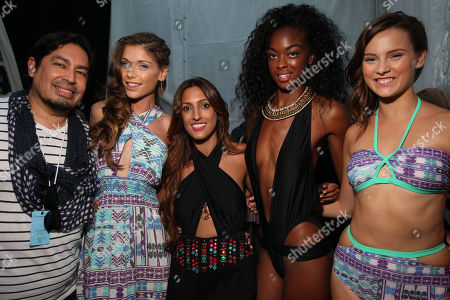 Stock Photo of Stylist Danny Santiago and designer Pooja Kharbanda, center, pose with models backstage after the 6 Shore Road runway show on Day 5 of the Mercedes-Benz Fashion Week Swim 2014 on at The Raleigh Hotel in Miami Beach, FL
