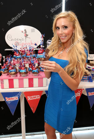 Stock Picture of Casey Reinhardt, owner of Casey's Cupcakes, participates in the kick-off of the Nestle Crunch 75th Birthday Showdown at Sweet E's on in Los Angeles. Fans can vote at Facebook.com/NestleCrunch for their favorite treat or bakery in the Nestle Crunch 75th Birthday Showdown