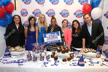 From left, Tricia Bowles, Nestle Crunch spokesperson, Nastassia Johnson, director of operations, Coolhaus, Casey Reinhardt, owner of Casey's Cupcakes, actress Rolonda Watts, Lisa Hess-Marks, head baker at Crumbs bakery, Erica Tucker, owner of Sweet E's and Matt Biggins, Nestle Crunch brand manager participate in the kick-off of the Nestle Crunch 75th Birthday Showdown at Sweet E's on in Los Angeles. Fans can vote at Facebook.com/NestleCrunch for their favorite treat or bakery in the Nestle Crunch 75th Birthday Showdown