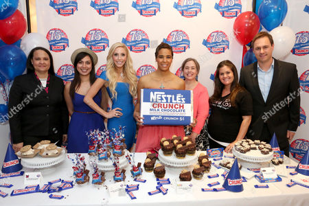 Stock Image of From left, Tricia Bowles, Nestle Crunch spokesperson, Nastassia Johnson, director of operations, Coolhaus, Casey Reinhardt, owner of Casey's Cupcakes, actress Daphne Wayans, Lisa Hess-Marks, head baker at Crumbs bakery, Erica Tucker, owner of Sweet E's and Matt Biggins, Nestle Crunch brand manager participate in the kick-off of the Nestle Crunch 75th Birthday Showdown at Sweet E's on in Los Angeles. Fans can vote at Facebook.com/NestleCrunch for their favorite treat or bakery in the Nestle Crunch 75th Birthday Showdown