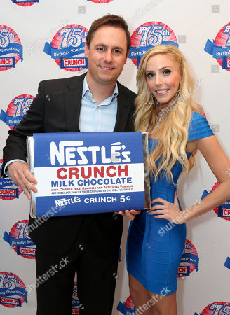 Matt Biggins, Nestle Crunch brand manager, left, and Casey Reinhardt, owner of Casey's Cupcakes, participates in the kick-off of the Nestle Crunch 75th Birthday Showdown at Sweet E's on in Los Angeles. Fans can vote at Facebook.com/NestleCrunch for their favorite treat or bakery in the Nestle Crunch 75th Birthday Showdown