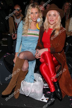 Stock Image of Whitney Tingle, left, and Danielle DuBoise, right, attend the Jeremy Scott NYFW Fall/Winter 2016 fashion show at Skylight at Moynihan Station, in New York