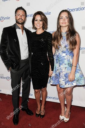 Stock Photo of From left, David Charvet, Brooke Burke-Charvet and Neriah Fisher arrive at Operation Smile's 2014 Smile Gala, in Beverly Hills, Calif