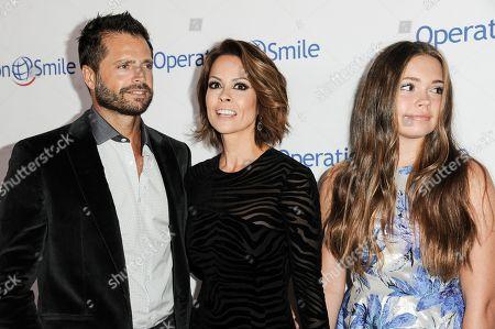From left, David Charvet, Brooke Burke-Charvet and Neriah Fisher arrive at Operation Smile's 2014 Smile Gala, in Beverly Hills, Calif