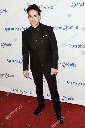 Michael Trevino arrives at Operation Smile's 2014 Smile Gala, in Beverly Hills, Calif