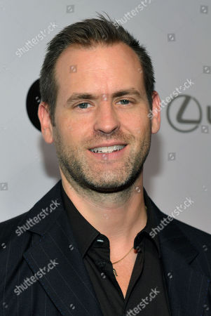 Stock Image of Matthew Breen, Editor in Chief of the Advocate, arrives at OUT Magazine's 20th Anniversary Party presented by Lexus at Station at W Hotel on in Los Angeles