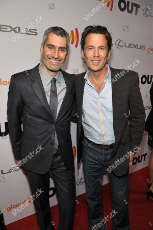 OUT Magazine Editor in Chief Aaron Hicklin, left, and actor David Millbern arrive at OUT Magazine Editor in Chief Aaron Hicklin arrives at OUT Magazine's 20th Anniversary Party presented by Lexus at Station at W Hotel on in Los Angeles