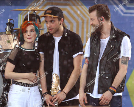 "From left, Hayley Williams, Taylor York and Jeremy Davis of Paramore perform on ABC's ""Good Morning America"" in Central Park, in New York"