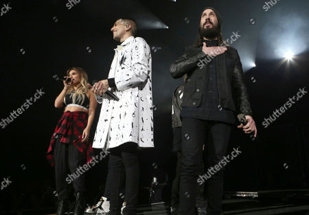 Stock Photo of Mitchell Grassi, Kirstin Maldonado and Avi Kaplan with Pentatonix performs at the Infinite Energy Arena, in Atlanta