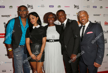 Stock Picture of Singer Fefe Dobson (2nd from L), Producer Jennifer Holness (C) and guests attend the Producers Ball 2012 at the Shangri-La Toronto, in Toronto, Canada