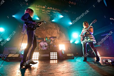 Sleater-Kinney seen in concert at Terminal 5, in New York Carrie Brownstein (guitar/vocals)\ (left), Janet Weiss (drums)\(middle), Corin Tucker (vocals/guitar) (right