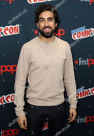 """Gregg Chillin, from """"Da Vinci's Demons"""", poses for photos during the STARZ press line at New York Comic Con on in New York"""