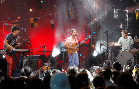 Members of the band Grizzly Bear, from left, Ed Droste, Daniel Rossen and Christopher Bear perform during StePhest Colbchella '012 Rocktaugustfest at the Intrepid Sea, Air & Space Museum, in New York