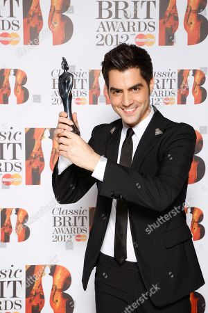 Milos Karadaglic seen with his Classical BRIT award for Breakthrough Artist of the Year at the Royal Albert Hall for the Classical BRIT Awards on in London, UK