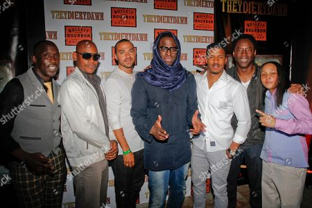 """Director Jeymes Samuel, center, is joined by cast members Michael K. Williams, Bokeem Woodbine, Jesse WIlliams, Nate Parker, Isaiah Washington and Felicia Pearson, left to righ, on the red carpet at the Bulleit Bourbon presents """"They Die by Dawn"""" premiere at SXSW, on in Austin, Texas"""