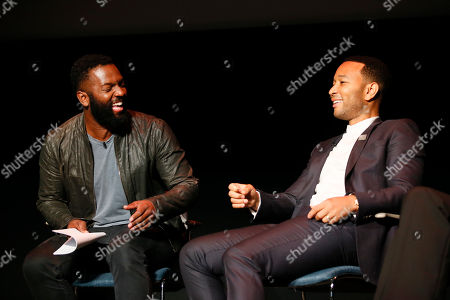 Moderator Baratunde Thurston, left, and John Legend, right, participate in the Television Academy's UNLOCK OUR POTENTIAL member event at the Academy's Wolf Theater and Saban Media center on in Los Angeles