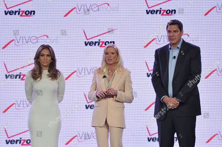 Stock Photo of From left, recording artist Jennifer Lopez, Marni Walden, Verizon Wireless Executive Vice President & COO and Marcelo Claure, President, Chairman and CEO of Brightstar Corp. announce Viva Movil by Jennifer Lopez at the Verizon Wireless Press Conference on in Las Vegas