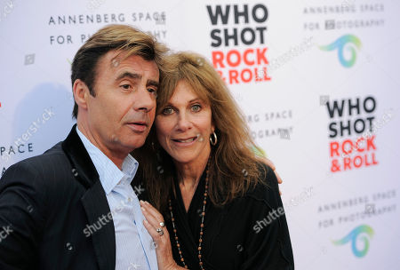 """Photographer Lynn Goldsmith poses with original Sex Pistols bassist Glen Matlock at the """"Who Shot Rock and Roll"""" photo exhibition opening at the Annenberg Space for Photography on in Los Angeles"""