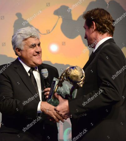 Jay Leno, left, presents the Alfred Mann Foundation award for innovation and inspiration to Wayne Gretzky at the 10th annual Alfred Mann Foundation Gala, in Beverly Hills, Calif