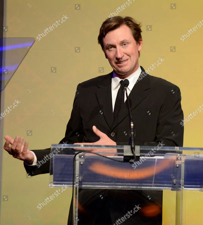 Wayne Gretzky speaks on stage at the 10th annual Alfred Mann Foundation Gala, in Beverly Hills, Calif