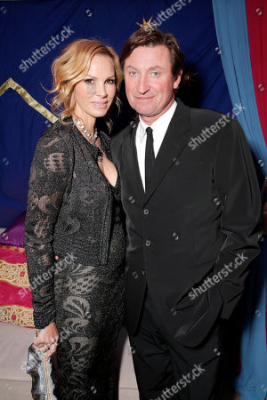 Stock Image of Janet Jones, left and Wayne Gretzky attend the 10th annual Alfred Mann Foundation Gala, in Beverly Hills, Calif